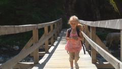 Child Walking on a Bridge over a Mountain River, Tourist in a Trip, Children Stock Footage
