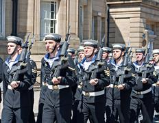 Members of the british armed forces marching through liverpool Stock Photos