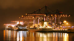 Timelapse of container harbor of Hamburg at night - stock footage