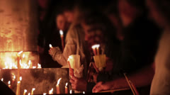 Religious people lighting candles Stock Footage