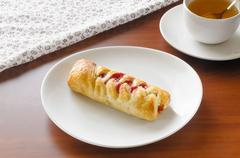 Flaky pastry with cherry jam Stock Photos