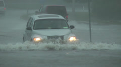 A vehicle ploughs through flood water - stock footage