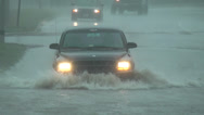 Stock Video Footage of A vehicle ploughs through flood water