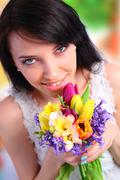 Young woman holding a bouquet Stock Photos