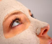 spa clay mask on a woman's face - stock photo