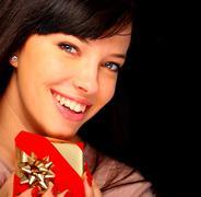 Stock Photo of beautiful woman holding a gift