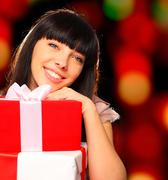 Portrait of a smiling woman holding gift boxes Stock Photos