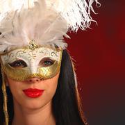 young woman wearing a venetian mask - stock photo