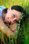 young woman relaxing in the park - stock photo