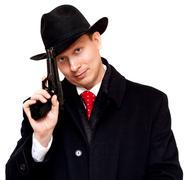 Man in suit, red tie with gun Stock Photos