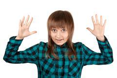 Beautiful girl in plaid shirt and hand upwards Stock Photos