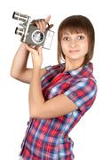 girl in plaid shirt with movie camera - stock photo