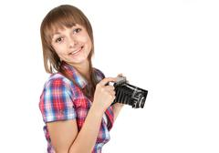 young girl with old analog photo by camera - stock photo