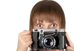 portrait young girl with old analog photo by camera - stock photo