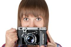 Portrait young girl with old analog photo by camera Stock Photos