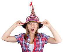 Young beautiful girl in colour hat Stock Photos