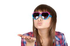 portrait girl in sunglasseses sends air kiss - stock photo