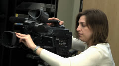 Woman running video camera. Stock Footage