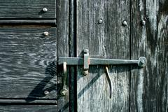 old iron door latch - stock photo