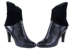 black feminine leather boots with suede insertion - stock photo