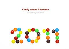 2011 made of candy coated chocolate isolated on white - stock photo