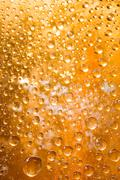 golden water droplets background - stock photo