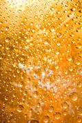 golden water droplets - stock photo