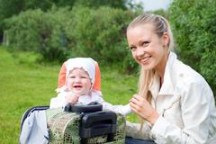 Younger woman and child in valise Stock Photos