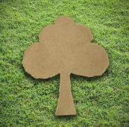 Tree paper attach on grass background Stock Photos