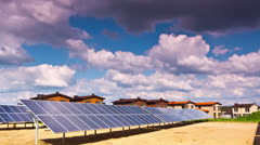 Solar panels and modern village Stock Footage