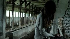 Girl Tortured by Mental Illness Sitting in Ruins Psychological Concept HD  Stock Footage