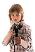 Young beautiful girl with perforator Stock Photos