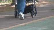 Stock Video Footage of Blue jeans women walks on park with prams