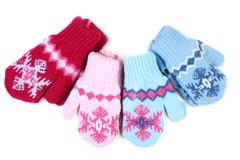 Baby knitted mittens with pattern Stock Photos