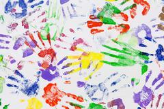 Varicoloured imprint of the hands Stock Photos