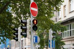 Sign prohibits travel and traffic lights Stock Photos