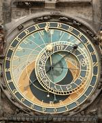 clock on the old living surface in prague - stock photo