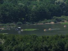 MONTICCHIO lake with paddle boats pan Stock Footage