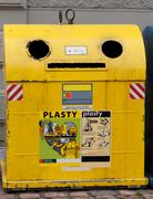 yellow trash on the streets of prague - stock photo