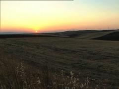 SOUTH ITALY countryside at sunset long shot pan Stock Footage