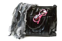 feminine bag with scarf and rose-colored glasses - stock photo