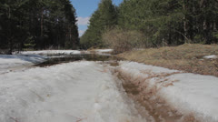 Spring road under water after snow melting Stock Footage