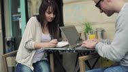 Young students with notebook and laptop computer in cafe HD Stock Footage
