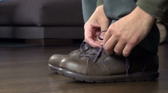 Man tying his shoelaces Stock Footage