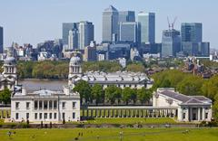 View of Docklands and Royal Naval College in London. Stock Photos