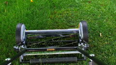Cutting the Grass with Push Mower POV Stock Footage