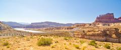 bridge over the dirty devil river, glen canyon, ut - stock photo