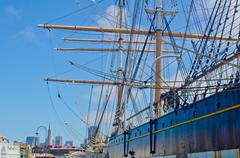 the mast rigging of a sailing ship docked at fisherman's wharf in san francis - stock photo