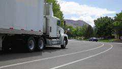 1003 semi-truck 18 wheeler drives away from camera Stock Footage