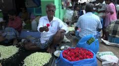 India man in a Madurai flower market Stock Footage